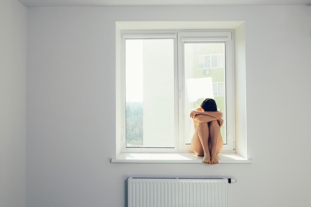 depressive moods rehabilitation treatment sad woman hug her knee and cry on window