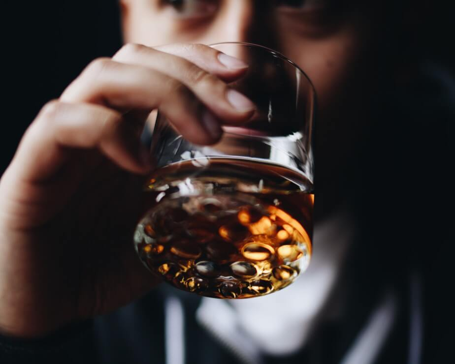 whiskey abuse hand glass alcohol drinking too much intensive outpatient san diego california
