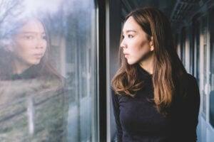 woman looking through window on the train meth detox sd ca