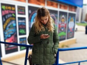 young woman reading a sad massage on her mobile phonesuffering depression