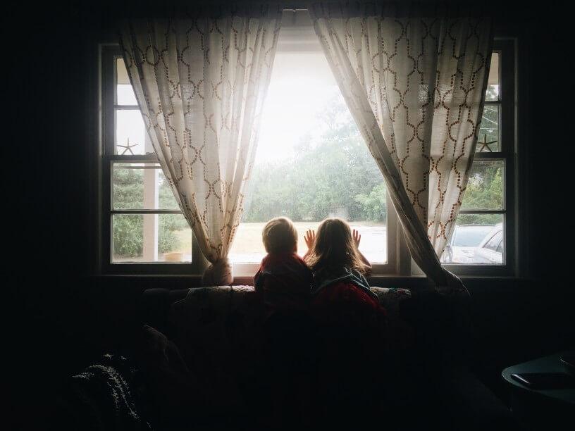 children at window indoors sad supporting mental health children feelings
