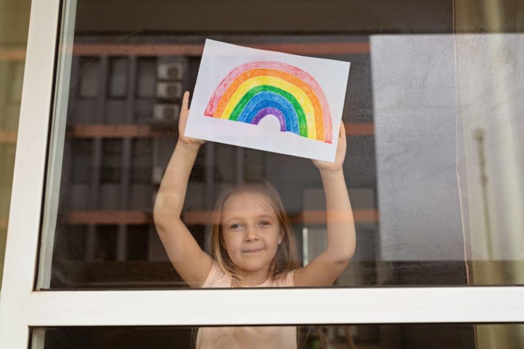 little girl with blonde hair having fun at home during coronavirus pandemic mental health children helping